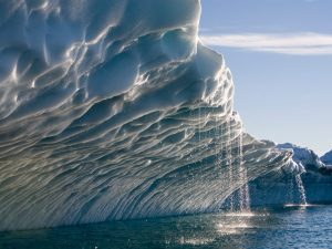 31 Jul 2006, Ilulissat, Greenland --- Melting water streams from iceberg calved from Ilulissat Kangerlua Glacier (Jakobshavn Icefjord) in Disko Bay. --- Image by © Paul Souders/Corbis